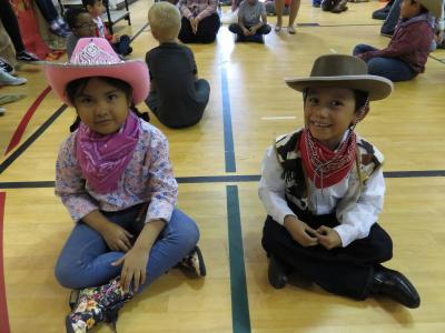 photo of students in cowboy outfits