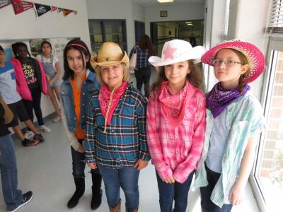 photo of fourth graders in cowboy outfits